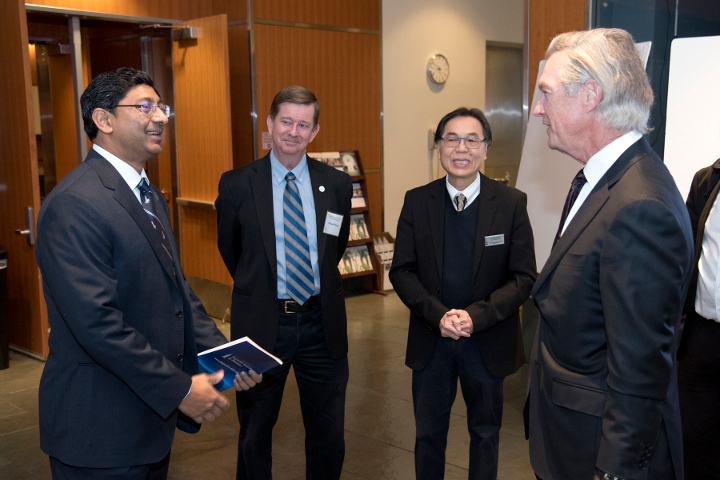 Dean Ravi Bellamkonda, Professor Tuan Vo-Dinh and Michael Fitzpatrick chat with guests at the FIP Symposium