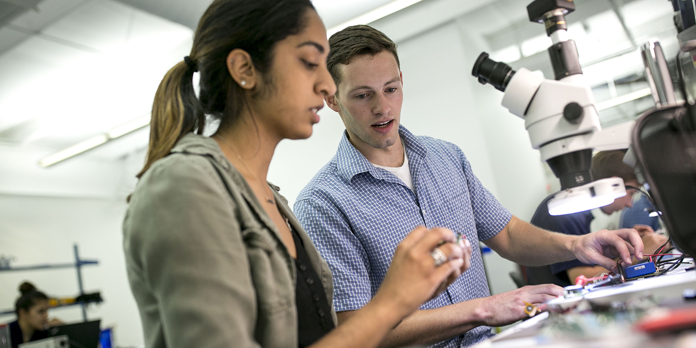 student interns work with a microscope in Research Triangle Park