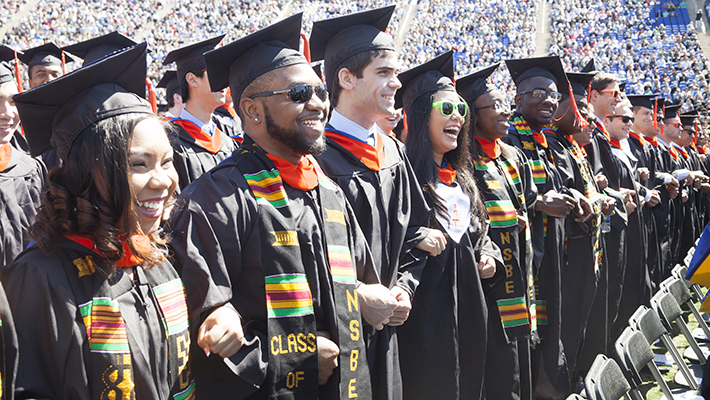 Duke engineering students at commencement in Wallace Wade Stadium