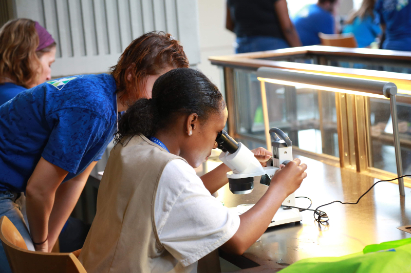 girl scout with microscope