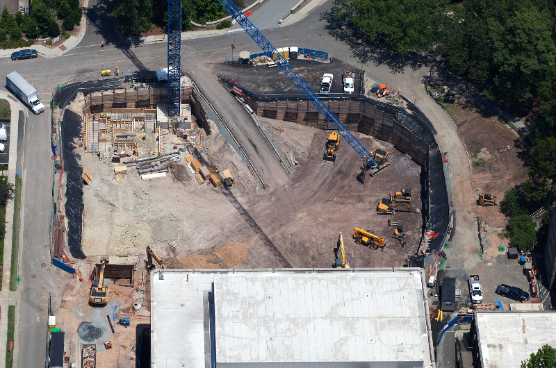 Overhead construction photos of a foundation and cranes
