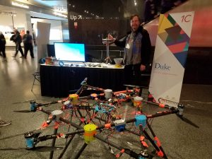 Martin Brooke stands with his student team's heavy lift drone