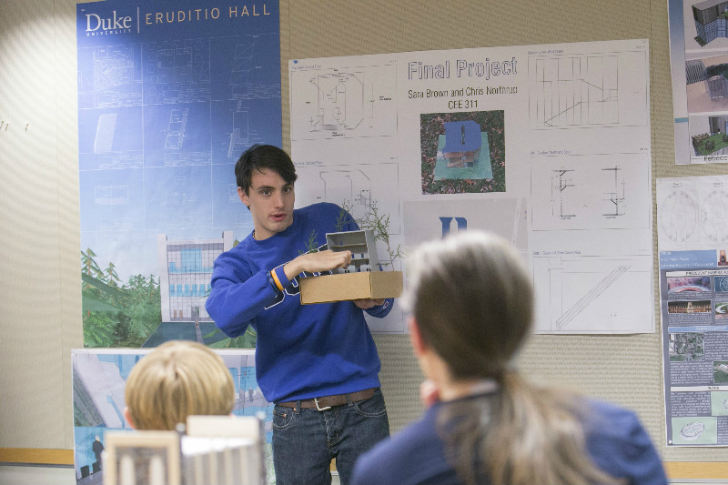 A Duke student shows off his building design