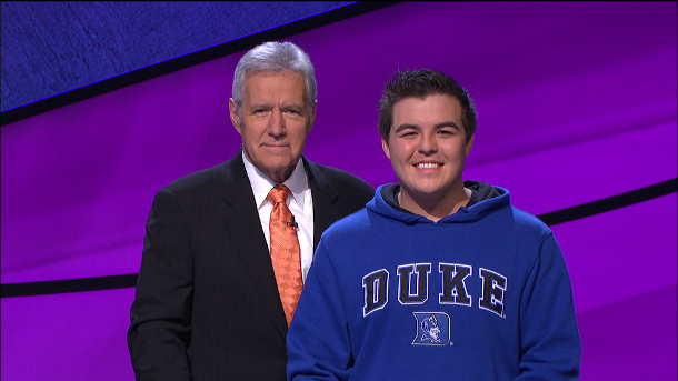 Cameron Kim with Jeopardy host Alex Trebek