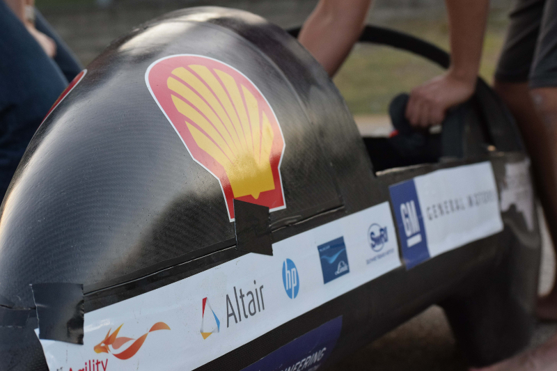 A closeup view of the nose of the small competition car