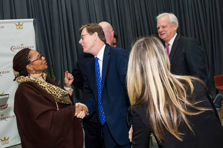 Duke President Vince Price talks with former Durham City Councilwoman Cora Cole-Mcfadden. Photo by f8 Photo Studios