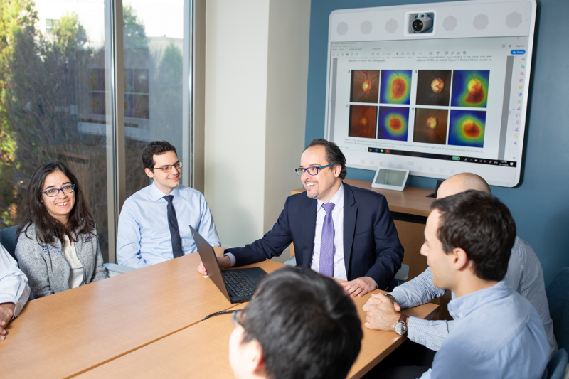 Filipe Medeiros with his research team around a table