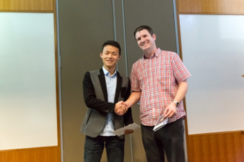 Zhihui Cheng shakes hands with his advisor Aaron Franklin at the 5th Annual Mahato Memorial event