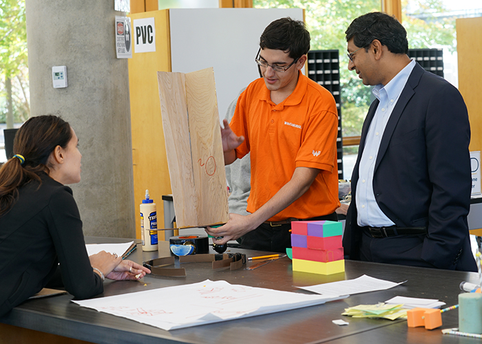 Dean Ravi Bellamkonda with student in Design Pod