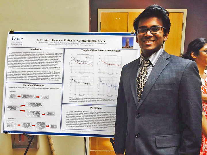 Vinay Nagaraj at a a Duke research fair where he presented his research about cochlear implants