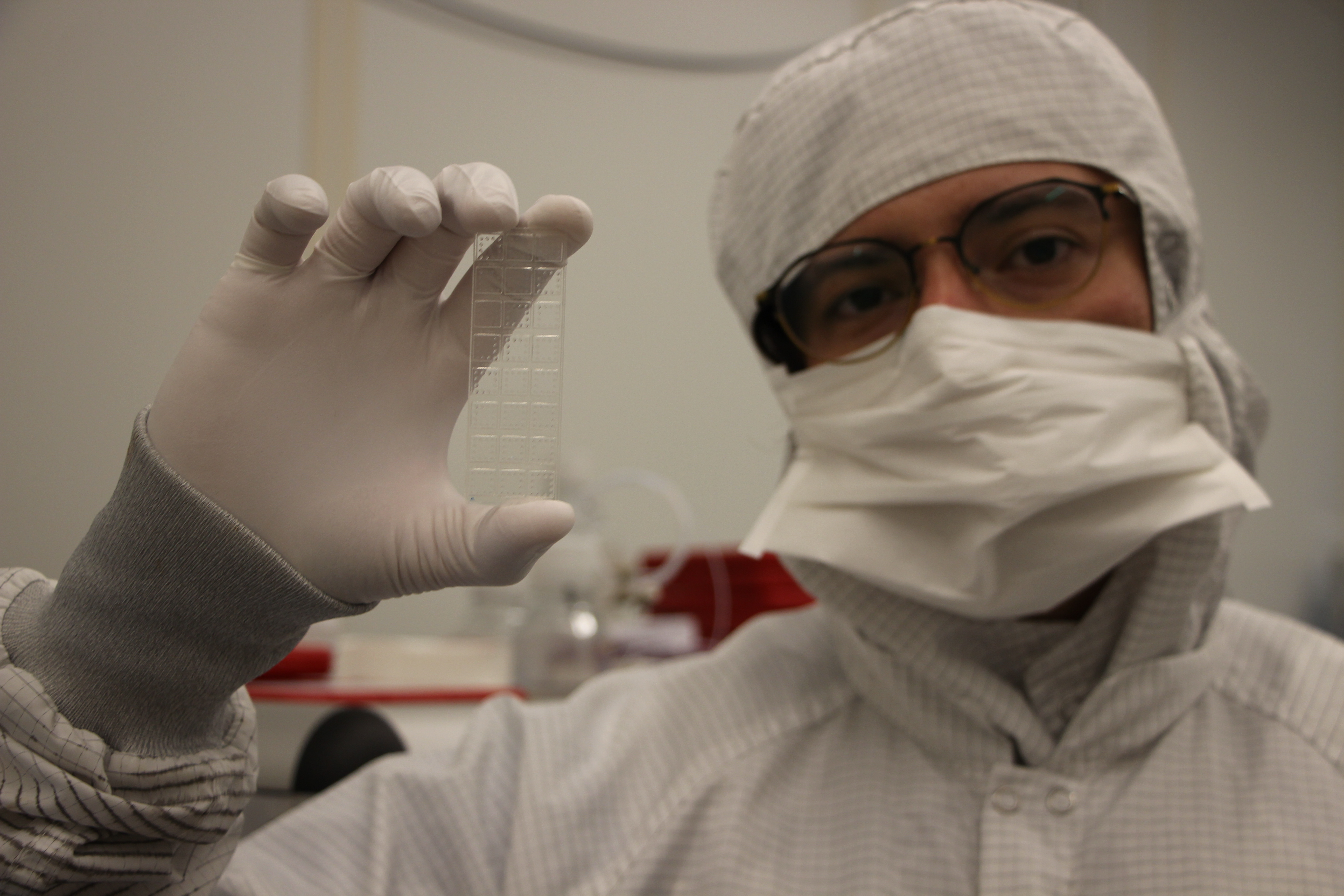 Cassio Fontes, PhD, holds up the D4 assay