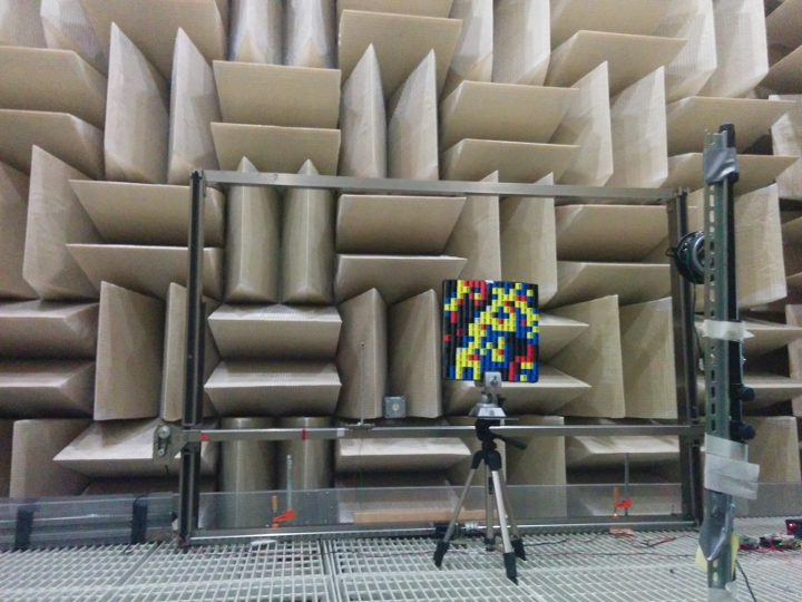 The metamaterial device is set up for testing in front of a sound-absorbing wall so that reflecting sound waves do not affect the experiments.