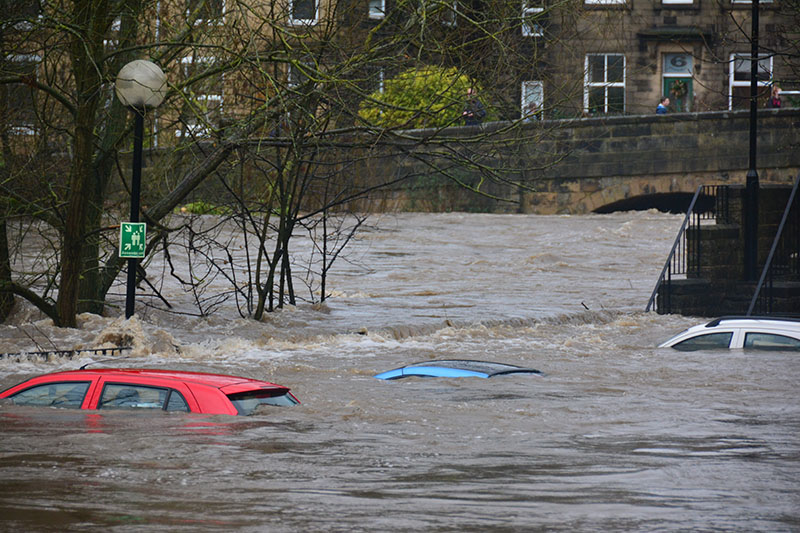 cars buried in floodwaters