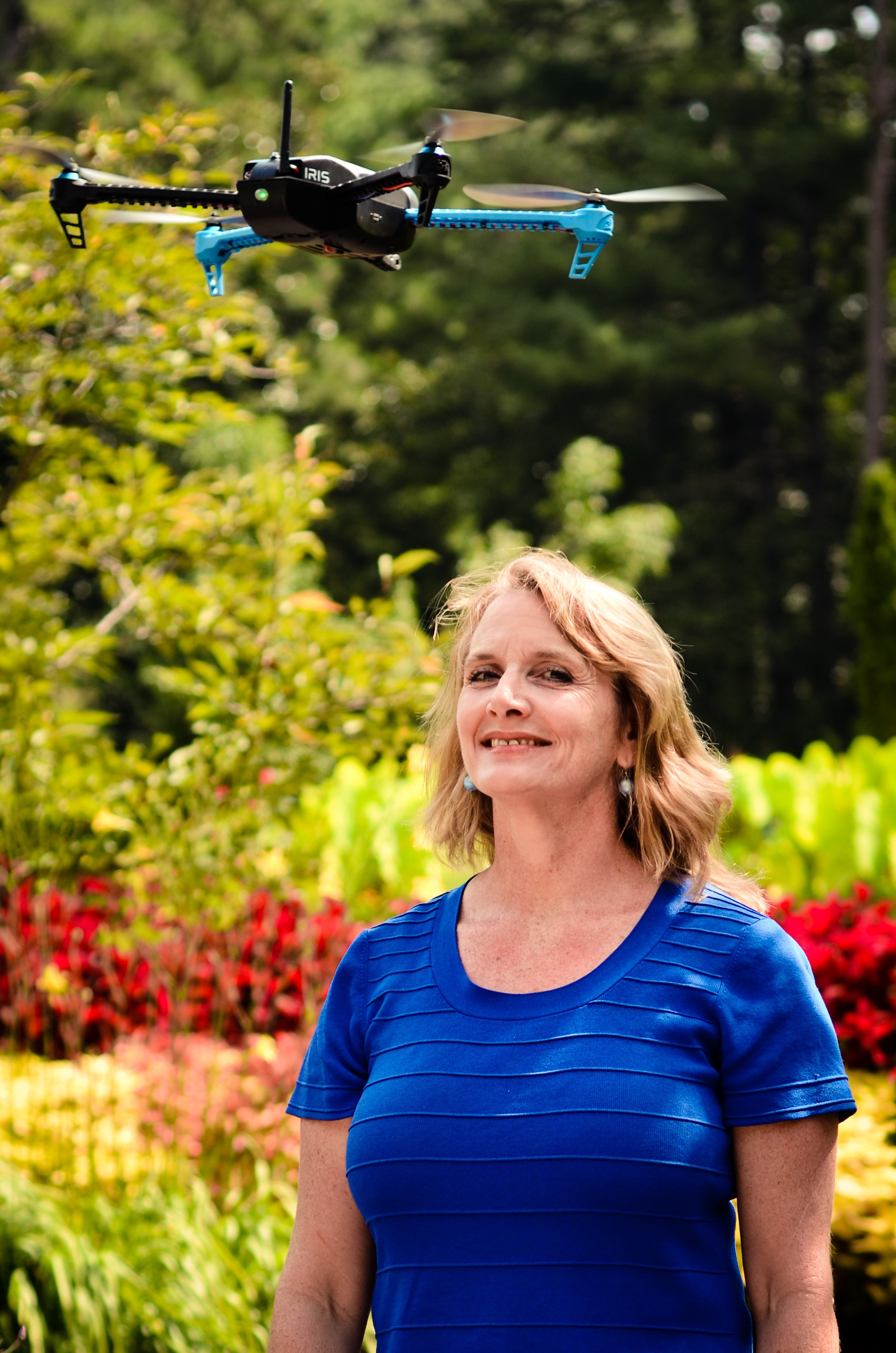 Mary 'Missy' Cummings standing with a hovering drone in the Sarah P. Duke Gardens at Duke University, where she will work to generate a set of inexpensive, unobtrusive best practices to deter unwanted drone usage.