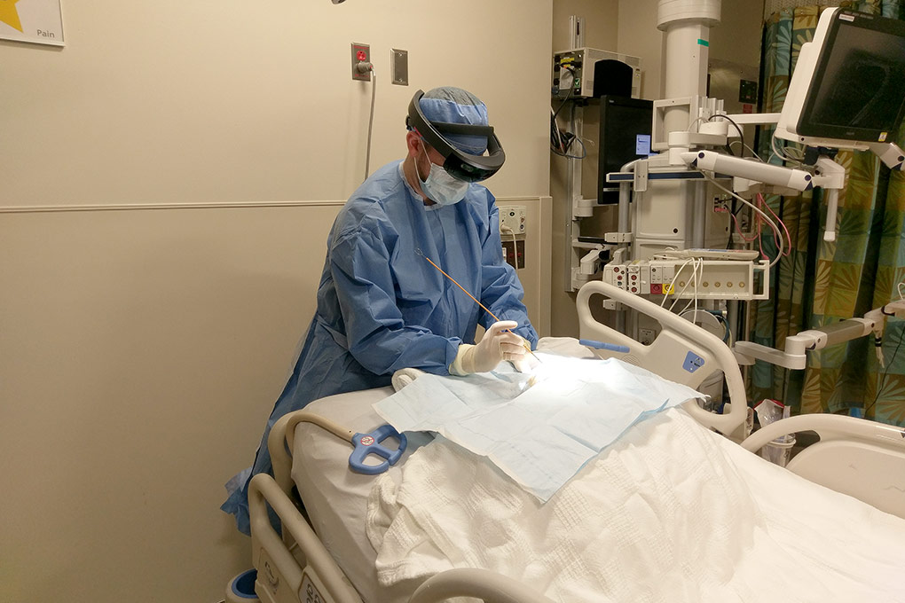 Neurosurgery resident Andrew Cutler demonstrates how HoloLens-aided EVD placement might look when performed in a clinic or ER. Photo courtesy of Andrew Cutler.