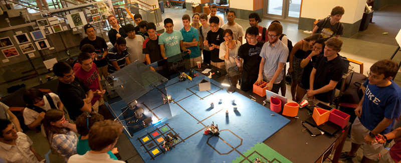 Duke engineering students test robots on an obstacle course