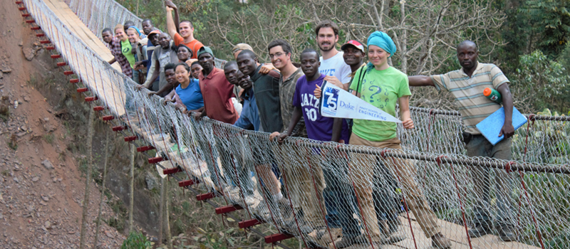 Duke Engineers for International Development with partners on a newly-constructed bridge in Rwanda
