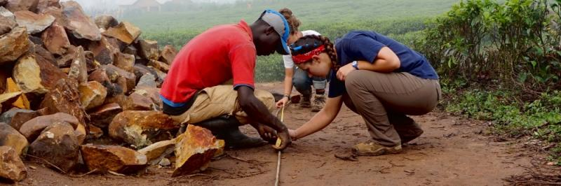 Duke Engineering students and constructing a local partners build a suspended bridge in Rwamahwa, Rwanda