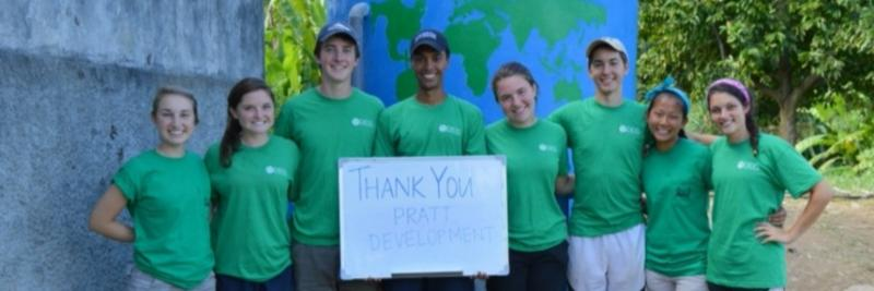 Duke Engineers for International Development (DEID) students with thank you sign