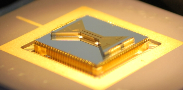 A micro-fabricated ion trap built on a silicon substrate and packaged in a standard ceramic pin-grid array (CPGA). The trap was used by Kim's laboratory in their quantum computing experiments and was fabricated by Sandia National Labs in a collaborative effort.