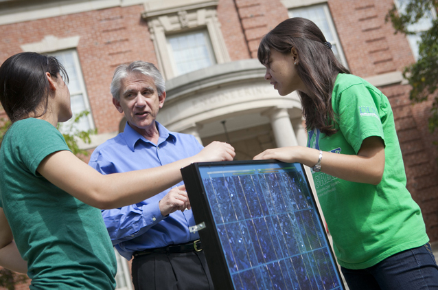 Students working on a solar project with a professor