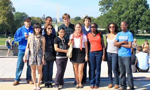 Milkie Vu from Vietnam, faculty adviser Ana Barros and Laxmi Rajak from Nepal (front row, left to right) joined other Karsh International Scholars on a trip to Washington, D.C., during fall break.