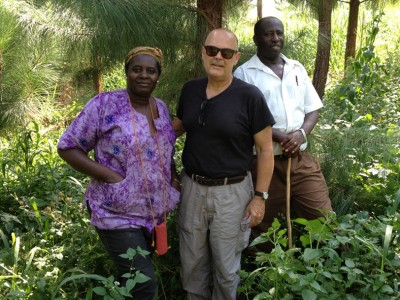 Christmas season 2014 at the Ibingira tree farm in Uganda. From left - Lydia Ibingira, principal of Crane Academy K-12 School, William Reichert, founder of the Duke-Makerere BME partnership, and Charles Ibingira, principal of the Makerere University College of Health Sciences.