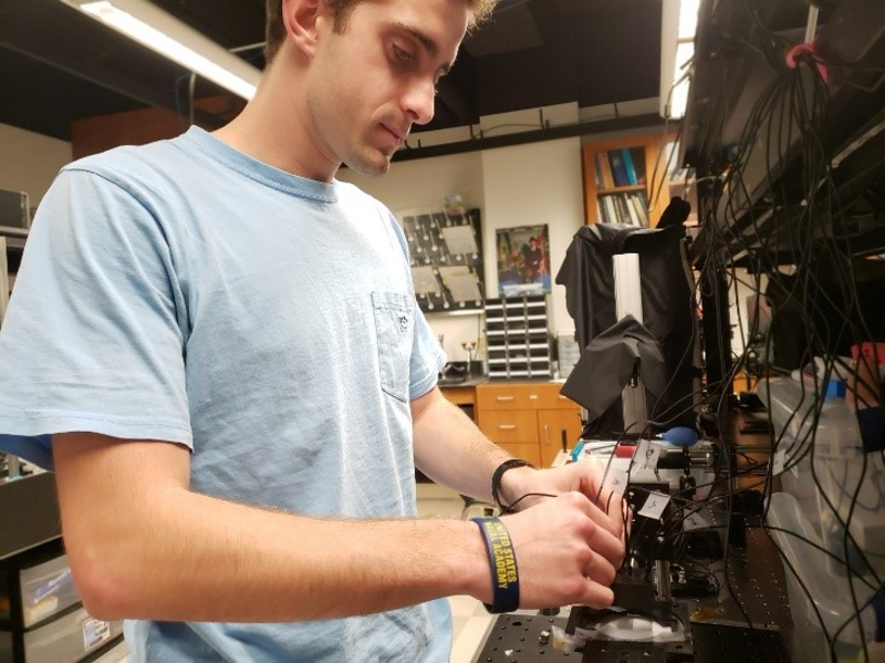 A student working on a project in a machine shop