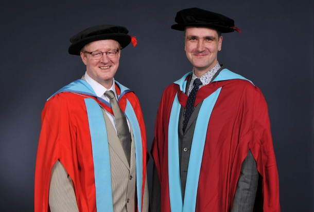 Needham in full, honorary-degree-regalia with Professor Phil Williams, head of the division of biophysics and surface analysis at the University of Nottingham. Williams was Needham's orator at the graduation ceremony and is now Needham's new colleague under his on-going honorary professorship at the Nottingham pharmacy school.