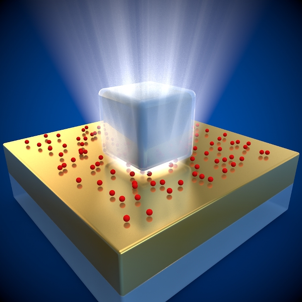 An illustration of the new superfast fluorescent system. The silver nanocube sits on top of a thin gold foil, with red quantum dots sandwiched between.