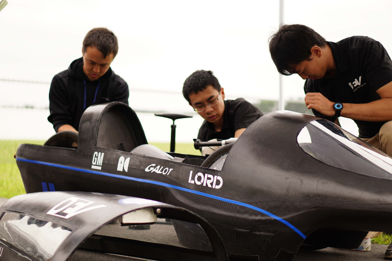 Students working on the car