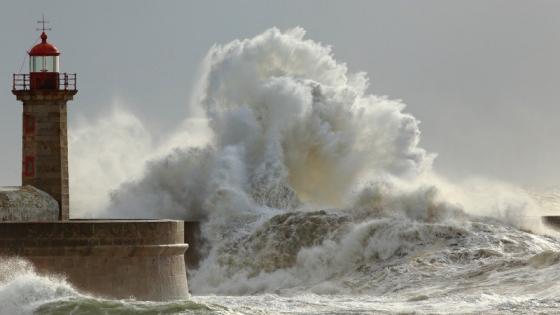 wave crashing into lighthouse