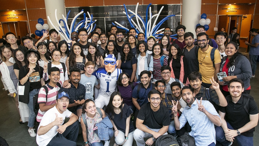 crowd of graduate students with the Duke Blue Devil