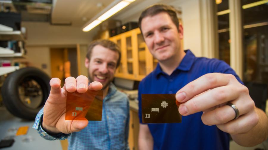 Aaron Franklin and lab member show tire sensor invention