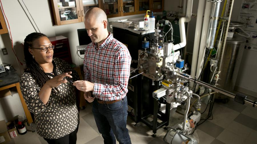 Professor Adrienne Stiff-Roberts with PhD student in lab