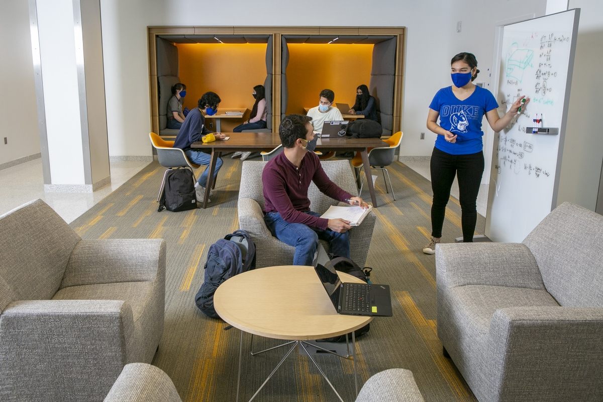 students collaborate at a whiteboard in the Learning Commons