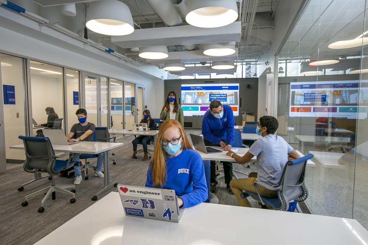 students work at laptops in the glass-walled Sondland Durant Center for Entrepreneurship