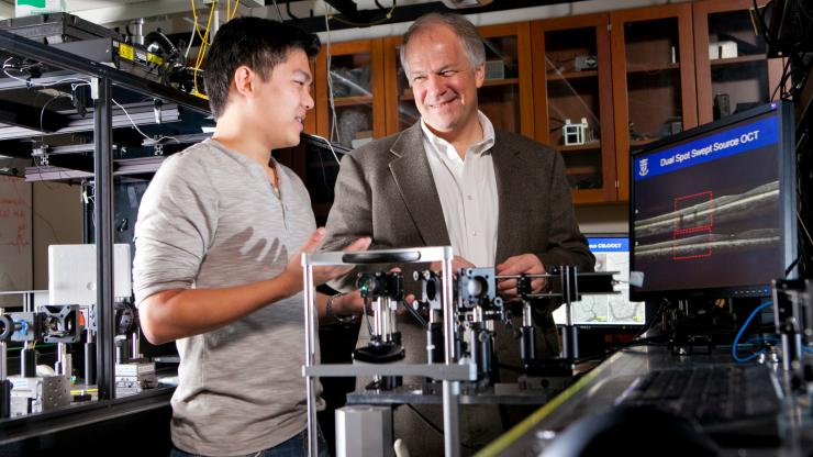 Professor Joe Izatt with student in photonics lab