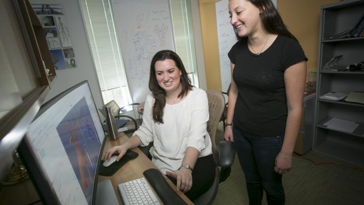 Professor Amanda Randles works with undergraduate student Stephanie Musinsky.