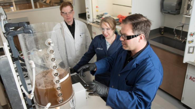 Researchers Brian Hawkins, Katelyn Sellgren and James Thostenson work together at the Center for WaSH-AID.