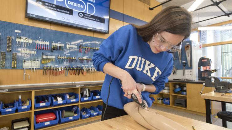 An engineering student works on the IV project for the First-Year Design Experience