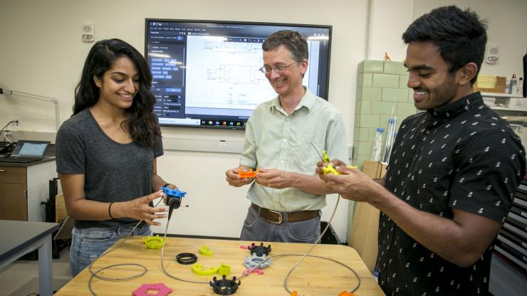 Students with prototype endoscopy dials. Photo credits, Chris Hildreth