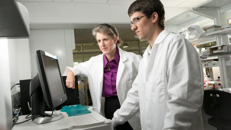 Jennifer West works with graduate student Jeffrey Ashton in her lab
