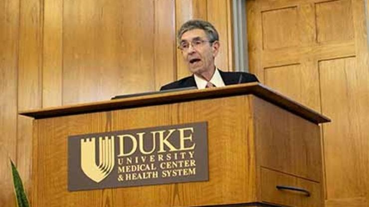 Robert Lefkowitz at a speaker podium