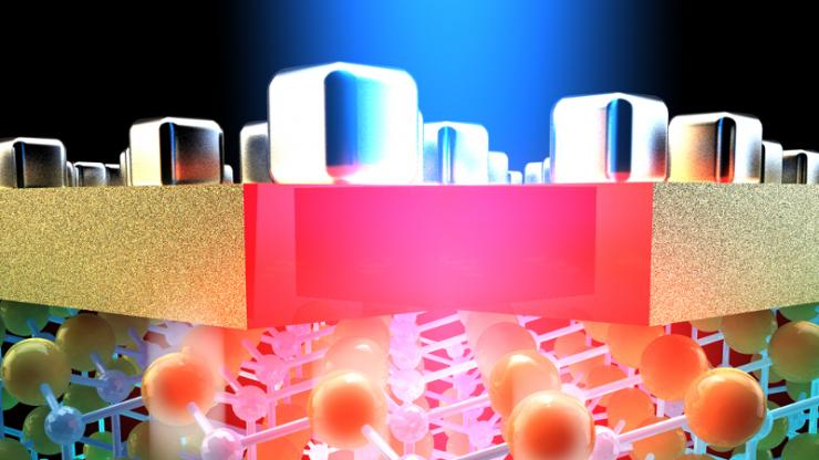 Light shining through silver cubes on top of a layer of gold with 3D molecules beneath