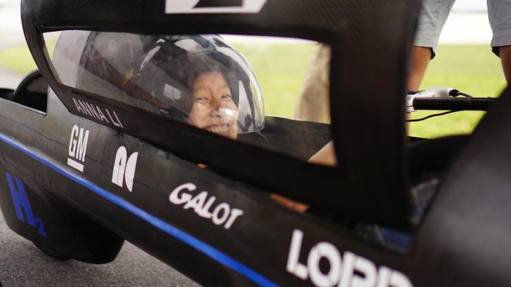Driver Anna Li behind the wheel of Maxwell, Duke's record-breaking vehicle