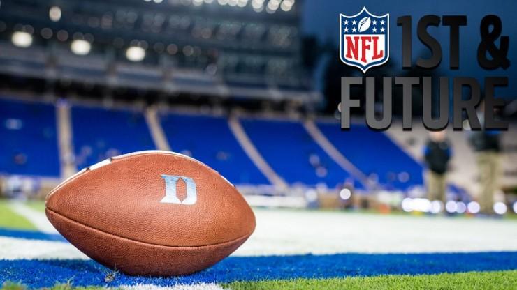 A Duke football on the Duke football field with the NFL logo