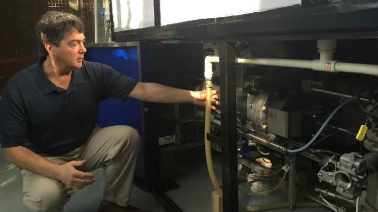 Brian Stoner, seen here with one of the prototype sanitation systems, is leading Duke's sanitation technology cluster