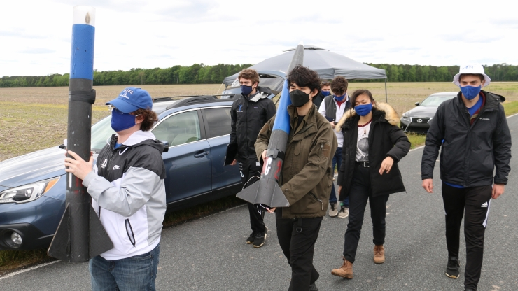 Duke University mechanical engineering students approach site to launch rocket