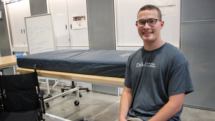 Samuel Fox poses with pieces of the project he is creating to improve patient mobility.